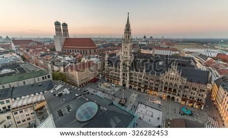 Munich City Skyline, Beautiful Panorama Aerial view of Munchen sunset panoramic architecture: Marienplatz, New Town Hall and Frauenkirche at Dusk, Bavaria, Germany.  - stock photo