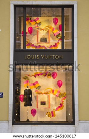 MUNICH - DEC 31: Shop windows are decorated at the Louis Vuitton store in Munich, Germany on December 31st, 2014. - stock photo