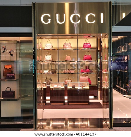 MUNICH, GERMANY - APRIL 1, 2014: Gucci store at Munich International Airport in Germany. The fashion company founded in 1921 is among most recognized luxury brands in the world. - stock photo