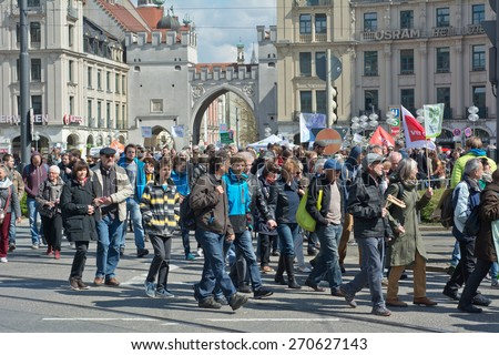 MUNICH, GERMANY - April 18, 2015:  Protesters turn out in force to protest TTIP trade deal, the Transatlantic Trade and Investment Partnership, in Munich Germany. - stock photo