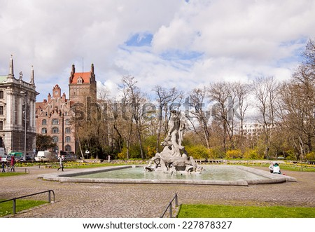 MUNICH, GERMANY-APRIL 12, 2012. The old botanical garden in Munich was opened in 1912. Nowadays remains on its premises a small park in city center with the Neptune fountain. - stock photo