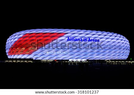 MUNICH, GERMANY - 4 AUGUST 2015: Allianz arena is a football stadium with a 75,024 seating capacity. It is the first stadium in the world with a full color-changing color exterior. - stock photo
