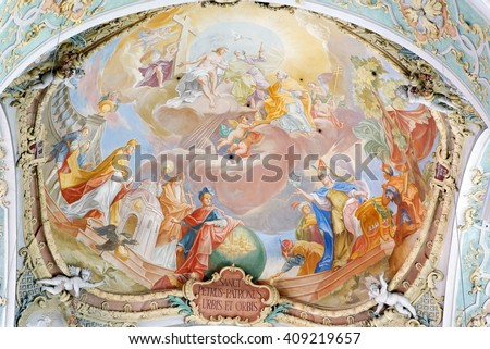 MUNICH, GERMANY - AUGUST 3, 2015: Interior of St. Peter's Cathedral, a Roman Catholic church in the inner city.  It is also the oldest church in the district. - stock photo