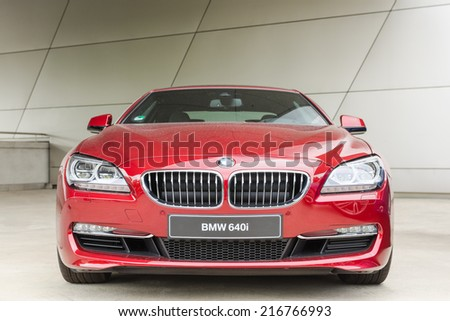 MUNICH, GERMANY - AUGUST 9, 2014: New modern model of BMW 640i first class exclusive business sedan car. - stock photo