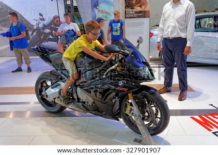 MUNICH, GERMANY - 4 AUGUST 2015: The original BMW S 1000 RR used in the film set of Mission: Impossible, Rogue Nation, starring Tom Cruise. BMW World showroom in Munich, Germany. - stock photo