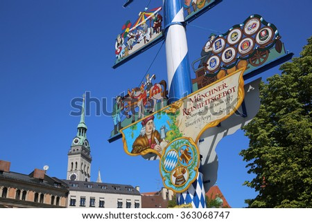 Munich, Germany - August 29, 2015: The Traditional Maypole at Viktualienmarkt in Munich. It carries figurettes displaying trades and crafts.  - stock photo
