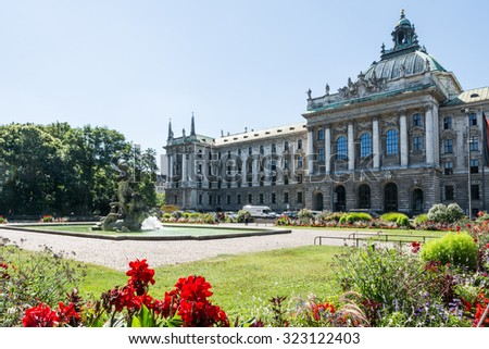 MUNICH, GERMANY - AUGUST 3: Tourists at the  the old botanical garden in Munich, Germany on August 3, 2015. The park was opened 1812.  - stock photo