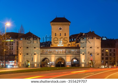 MUNICH, GERMANY - DECEMBER 24, 2015: Long exposure of the Isartor at Isartorplatz in Munich, one of four main gates of the medieval city wall, at night. - stock photo