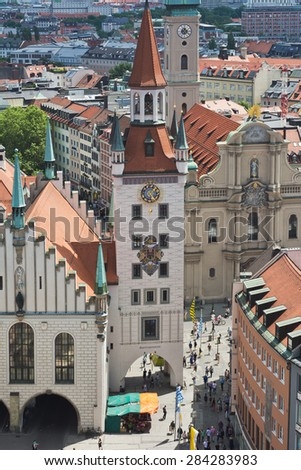 MUNICH, GERMANY - JUNE 3, 2015: Beautiful Weather Brings out Shoppers in Front of the Old City Hall on the Marienplatz in Munich, Germany. - stock photo