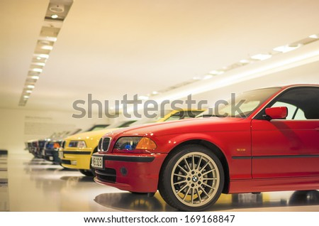 Munich, Germany- june 17, 2012: Row of Epochal 3rd series BMW's line-up shown on Stand in BMW Museum in June 17, 2012, Munich, Republic of Germany. Horizontal Image - stock photo