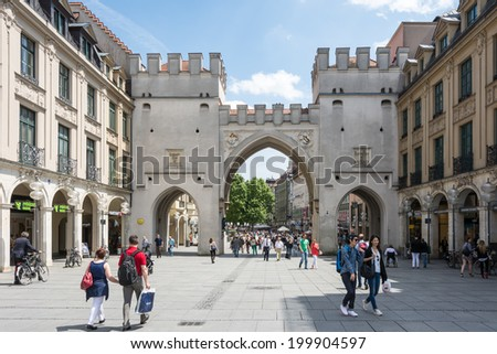 MUNICH, GERMANY - JUNE 4: Tourists in the pedestrian area of Munich, Germany on June 4, 2014. Munich is the biggest city of Bavaria  with almost 100 million visitors a year. - stock photo
