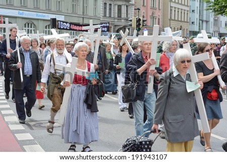 MUNICH, GERMANY - MAY 10, 2014:  Anti-Abortion Demonstration with participants carrying Christian Crosses and banners.  Hundreds protested peacefully in Munich.  - stock photo