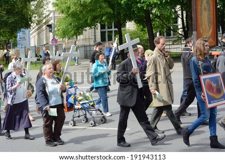 MUNICH, GERMANY -?? MAY 10, 2014:  Anti-Abortion Demonstration with participants carrying Christian Crosses and banners.  Hundreds protested peacefully in Munich.  - stock photo