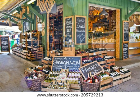 MUNICH, GERMANY - MAY 24,2014. Viktualien Markt open air market in Munich center is a shopping landmark in Munich center and offers daily gourmet delicacies and wines to  regular visitors and tourists - stock photo