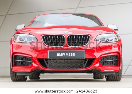 Munich, Germany - October 25, 2014: BMW M235i coupe the first M Performance series European small and inexpensive turbocharged mainstream passenger sports car front view - stock photo