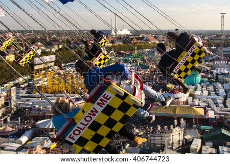 MUNICH, GERMANY - OCTOBER 02, 2015: Chairoplane ride on Oktoberfest with the carousel in motion and people flying through the air on Theresienwiese - stock photo