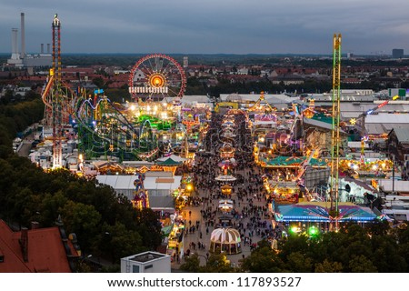MUNICH, GERMANY - OCTOBER 1: View of the Oktoberfest in Munich, Germany at night on October 1, 2012. Oktoberfest is a festival celebrating beer in Munich. - stock photo