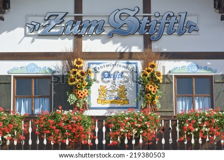 MUNICH, GERMANY - SEPT. 19, 2014: Beautifully Decorated Stiftl Hut with Flowers at the Oktoberfest. The Festival runs from Sept. 20 - Oct. 5  in Munich, Germany. - stock photo