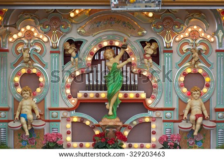 MUNICH, GERMANY - SEPT. 28, 2015: Decorated Old Fashioned Music Organ at the Oktoberfest. The Festival runs from September 19th until October 4th 2015 in Munich, Germany. - stock photo