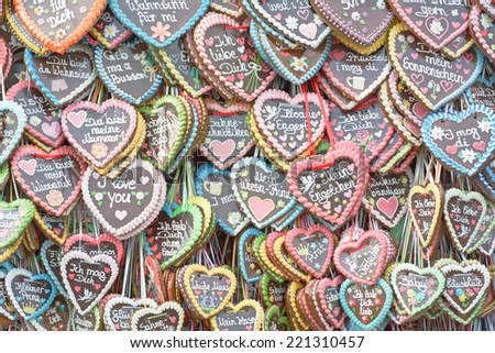 MUNICH, GERMANY - SEPT. 26, 2014:  Traditional Gingerbread Hearts at the Oktoberfest celebrating the festivities. The Festival runs from Sept. 20 - Oct. 5  in Munich, Germany  - stock photo
