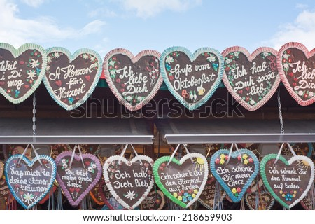 MUNICH, GERMANY -  SEPT. 21, 2014:  Traditional Gingerbread Hearts at the 181st Oktoberfest and festivities. The Festival runs from Sept. 20 - Oct. 5  in Munich, Germany  - stock photo