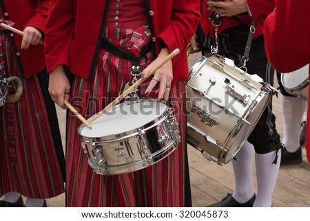 MUNICH, GERMANY - SEPT. 20, 2015: Traditional Marching Band with Woman Drummer entertain Crowds at the Oktoberfest.  The Festival runs from Sept. 19th until Oct. 4th 2015 in Munich, Germany. - stock photo