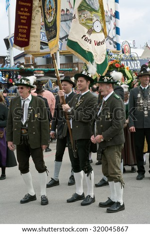 MUNICH, GERMANY - SEPT. 20, 2015: Traditional Marching Group with Costumes entertain Crowds of visitors at the Oktoberfest. The Festival runs from Sept. 19th until Oct. 4th 2015 in Munich, Germany. - stock photo