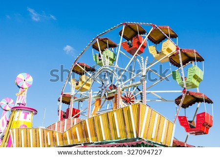 MUNICH, GERMANY - SEPTEMBER 30: Historic ferris wheel on Oktoberfest in Munich, Germany on September 30, 2015. Oktoberfest is the biggest beer festival of the world with over 6 million visitors. - stock photo