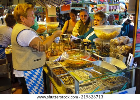 MUNICH, GERMANY - SEPTEMBER 23, 2014: The Oktoberfest in Munich is the biggest beer festival of the world with shops for sweets and candies - stock photo