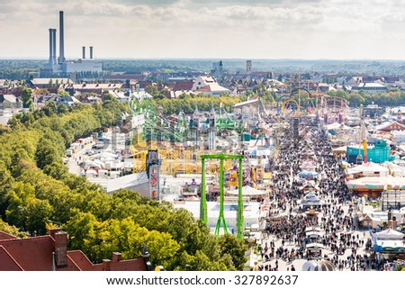 MUNICH, GERMANY - SEPTEMBER 30: View over the Oktoberfest in Munich, Germany on September 30, 2015. The Oktoberfest is the biggest beer festival of the world with over 6 million visitors. - stock photo