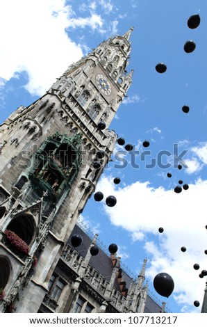 MUNICH - JULY 14: Black balloons forward the city hall as a sign for the deceased AIDS victims at the Christopher Street Day (Gay Pride) in Munich on July 14, 2012. - stock photo