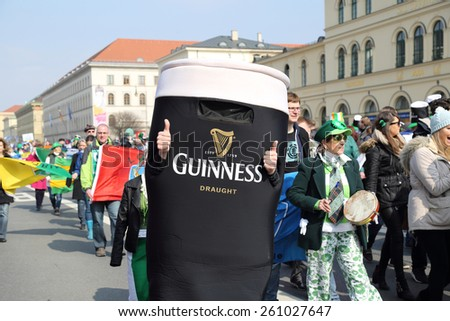 MUNICH - MARCH 15: irish beer advertising is marching at St. Patrick's day on March 15, 2015 in Munich, Germany. This national Irish holiday takes place annually  in Dublin and other European cities. - stock photo