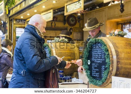 MUNICH - NOV 27: Stand at Christmas Market, Kaufingerstrasse    on November 27, 2015 in Munich, Germany - stock photo