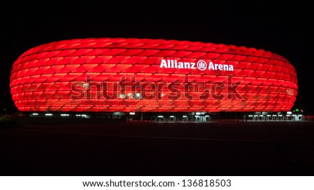 MUNICH - OCT 2: Allianz Arena at night on October 2, 2012. The Allianz Arena is a football stadium in Munich, Bavaria, Germany. It is the home of the FC Bayern Munich and TSV 1860 Munchen. - stock photo