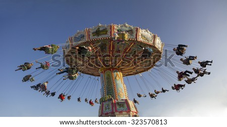 Munich Octoberfest 2. October 2015 - rotating chairoplane with people - stock photo