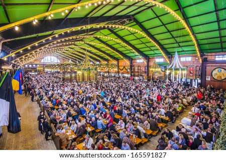 MUNICH - SEPTEMBER 30: Beer Tent on the Theresienwiese Oktoberfest fair grounds September 30, 2013 in Munich, Germany. - stock photo