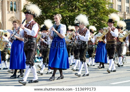 MUNICH - SEPTEMBER 23: Music brigade at the traditional costume and Riflemen's Parade during the Oktoberfest in Munich, Germany on September 23, 2012. - stock photo