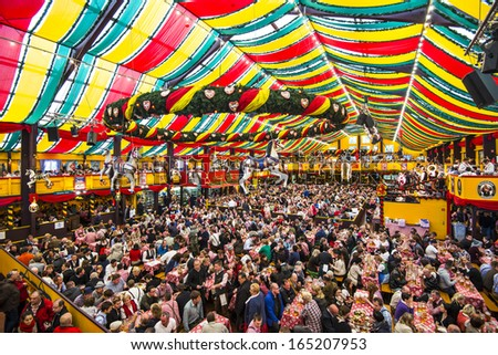 MUNICH - SEPTEMBER 30: The Hippodrom Beer Tent on the Theresienwiese Oktoberfest fair grounds September 30, 2013 in Munich, Germany. The Hippodrom was first opened in 1902. - stock photo