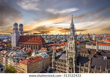 Munich sunset panoramic architecture, Bavaria, Germany. Frauenkirche and town hall on Marienplatz - stock photo