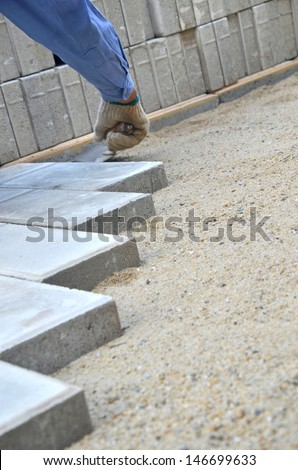 Municipal construction workers paving  - stock photo