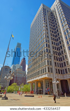 Municipal Services Building and skyscrapers in Philadelphia, Pennsylvania, the USA. It is central business district in Philadelphia. Tourists on the square. - stock photo