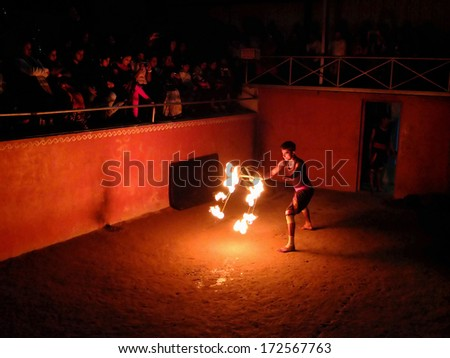 MUNNAR, INDIA - JANUARY 2: Man performing fire dance in the Thirumeny cultural centre on January 2, 2014 in Munnar, Kerala, India.  - stock photo