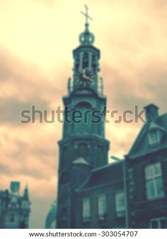 Munttoren clock tower in Amsterdam. Blurred toned photo. - stock photo