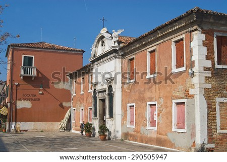 MURANO, ITALY - FEBRUARY 27, 2007: Exterior of the old abandoned building with decaying facade in Murano, Italy. - stock photo