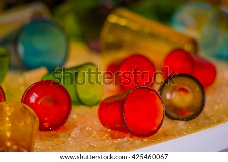 MURANO, ITALY - JUNE 16, 2015: Little colorfull glasses made by hand in Murano city, sale in the shop - stock photo