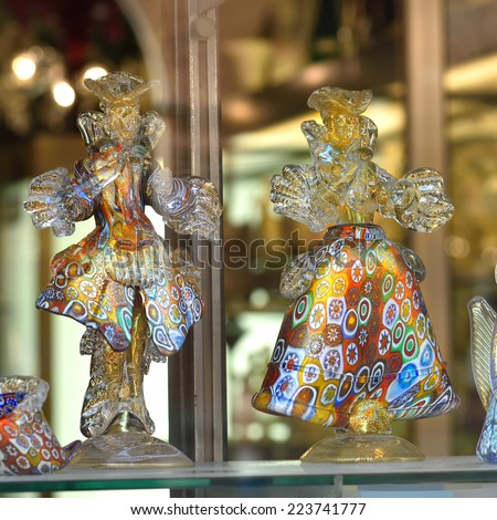 MURANO, ITALY - SEP 25, 2014: Glass figurines from murano glasses displayed in a shop window. Today, Murano is home to a vast number of factories  making all manner of glass objects  - stock photo