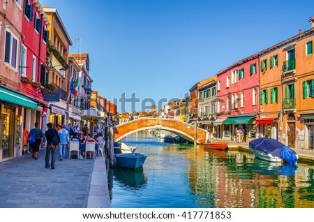 MURANO, ITALY, SEPTEMBER 20, 2015:view of a channel on murano island in italy which is surrounded with tourist shops selling famous murano glass - stock photo