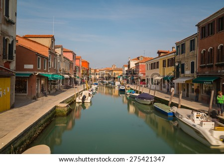 MURANO, ITALY - 14TH MARCH 2015: A view along Fondamenta Dei Vetrai and Fondamenta Daniele Manin footpaths in Murano during the day, showing shops, boats, buildings and people - stock photo