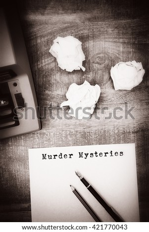 Murder mysteries message on a white background against view of an old typewriter and paper - stock photo