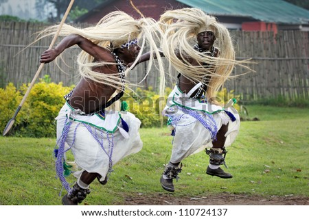 MUSANZE, RWANDA - JUNE 16: Tribal Dancers of the Batwa Tribe Perform Traditional Intore Dance to Celebrate the Birth of an Endangered Mountain Gorilla on June 16, 2012 in Musanze, Rwanda. - stock photo